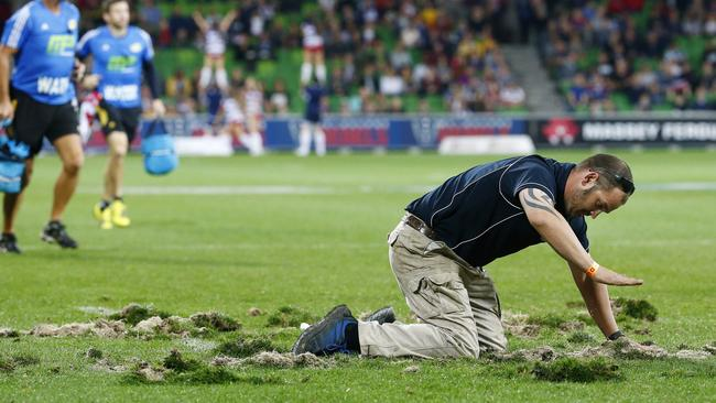 A groundsman works to repair the turf at halftime of the Rebels v Hurricanes Super Rugby match at AAMI Park in April.