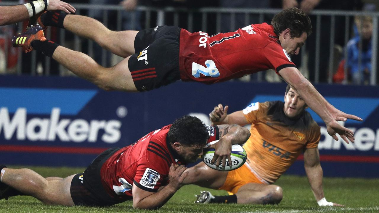 Crusaders hooker Codie Taylor dives across the line to score a try.