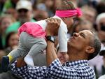 President Barack Obama lifts Stella Munoz into the air while greeting guests on the South Lawn of the White House during the annual White House Easter Egg Roll March 28, 2016 in Washington, DC. Picture: Win McNamee/Getty Images