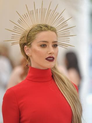 Amber Heard completes her outfit with an ornate gold crown. Picture: Getty