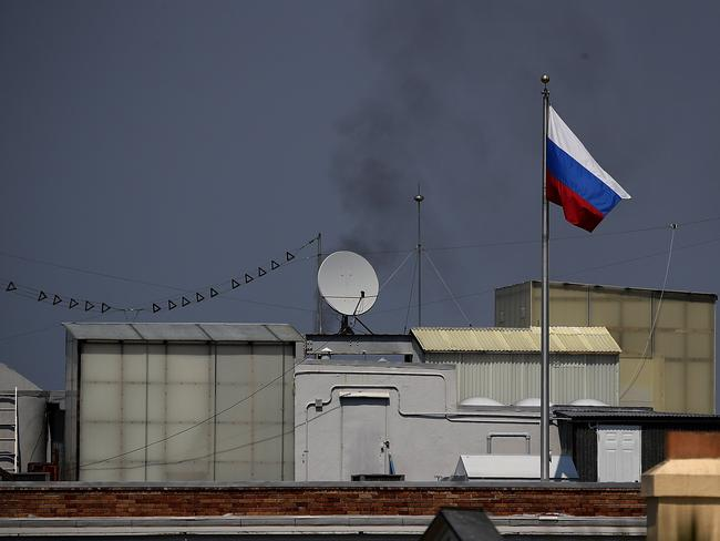 Black smoke billows from a chimney on top of the Russian consulate in San Francisco, California. Picture: AFP