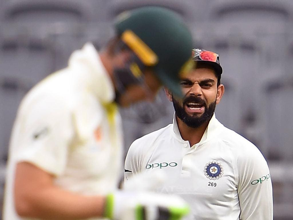 India's captain Virat Kohli (R) yells at Australia's captain Tim Paine (L) on the third day of the second cricket Test match in Perth on December 16, 2018. (Photo by WILLIAM WEST / AFP) / --IMAGE RESTRICTED TO EDITORIAL USE - STRICTLY NO COMMERCIAL USE--