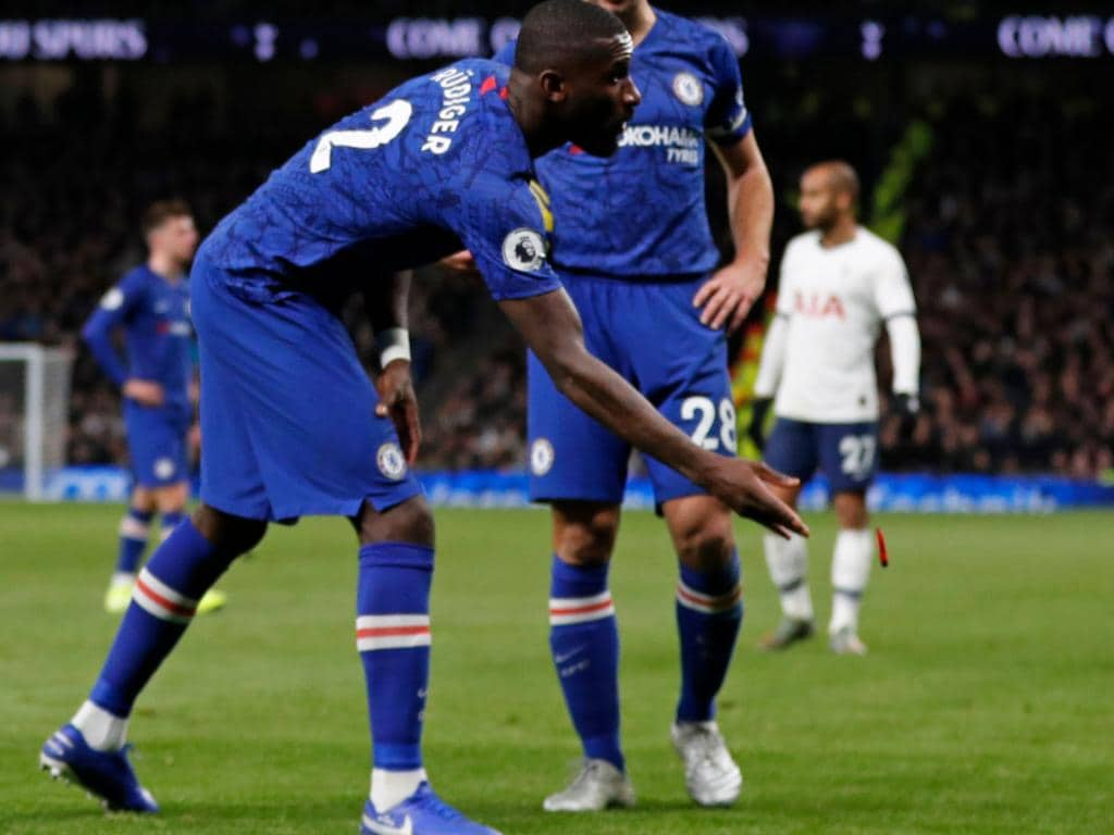 Antonio Rudiger throws an object off the playing surface as Spurs fans took things too far.