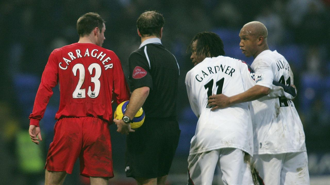 Diouf clashes with his former Liverpool teammate Jamie Carragher.