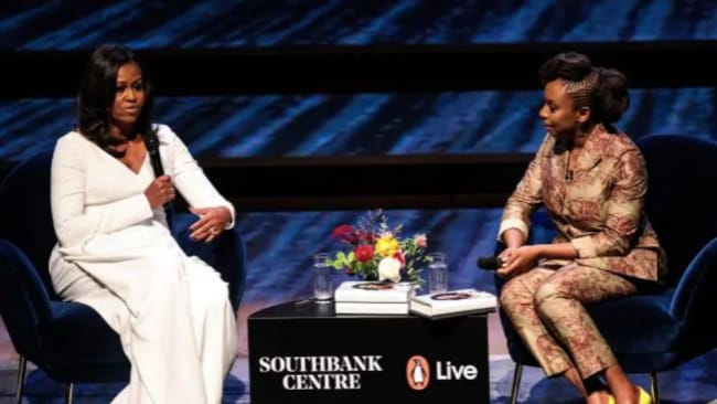 LMichelle Obama appeared on stage in London with Nigerian author Chimamanda Ngozi Adichie. Picture: Getty Images Source: Getty Images