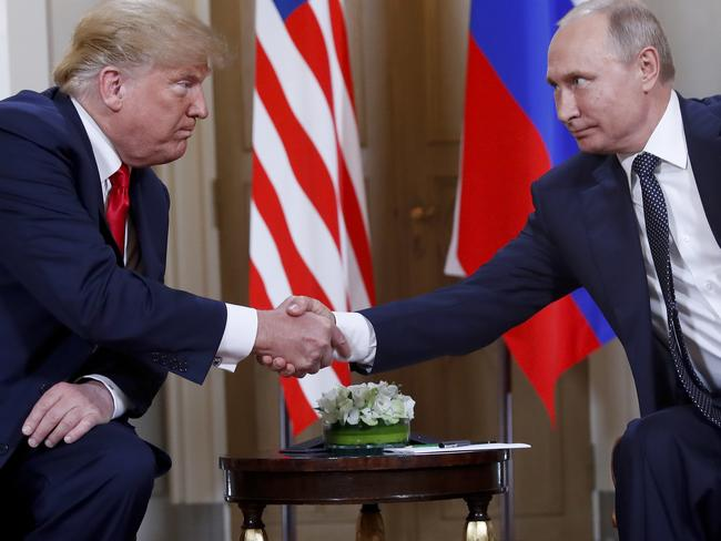 US President Donald Trump, left, and Russian President Vladimir Putin, right. Picture: AP