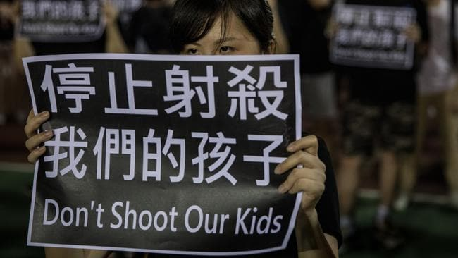 Protesters held signs saying 'Don't shoot our kids'. Picture: Chris McGrath/Getty Images