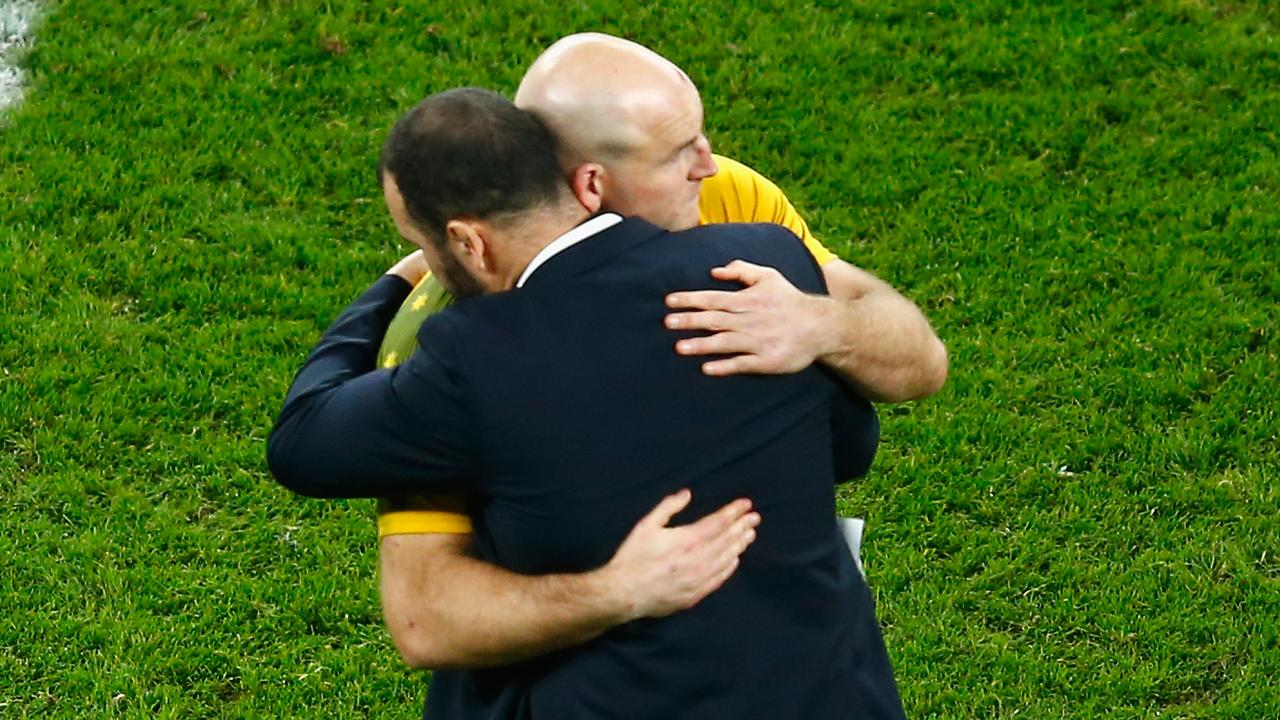 Michael Cheika consoles Stephen Moore after the 2015 Rugby World Cup loss to the All Blacks at Twickenham.