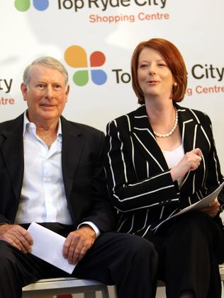 John Beville pictured with then Prime Minister Julia Gillard.