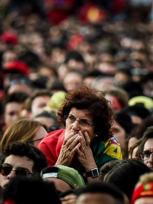 aba32f76d Picture  AP Photo A Portugal fan react as people watch the Russia 2018  World Cup football match between Portugal and Uruguay on a giant screen at  Comercio ...