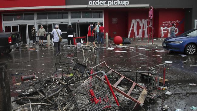 Upturned shopping carts outside a Target that's been targeted by looters. Picture: Jim Mone
