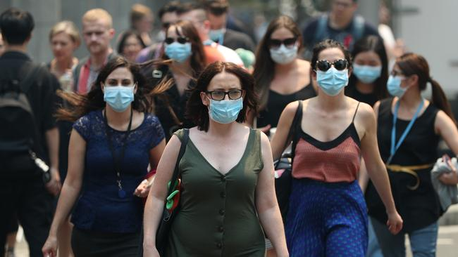 An increasing number of Aussies are donning face masks. Picture: Don Arnold/Getty Images