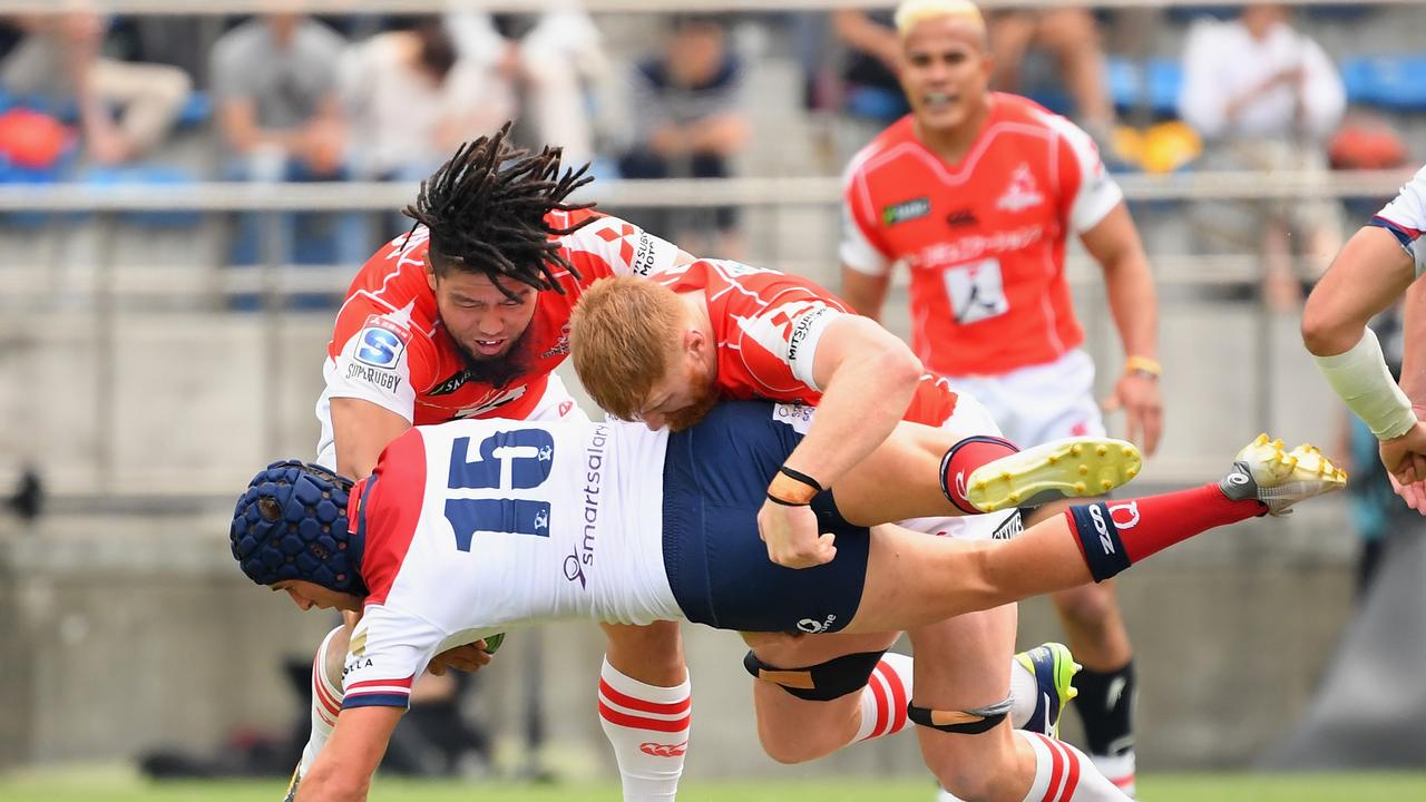 Hamish Stewart of the Reds is dumped by Shota Horie and Ed Quirk of the Sunwolves.