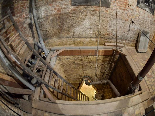 The shaft leading down into a tunnel at Bernauer Strasse has been reconstructed to show visitors what it would have been like. Picture: Tobias Schwarz / AFP