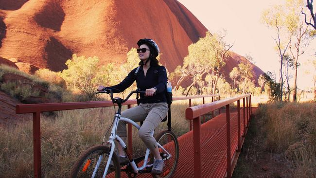 Tourists can enjoy a bicycle ride around Uluru. Picture: Tourism NT