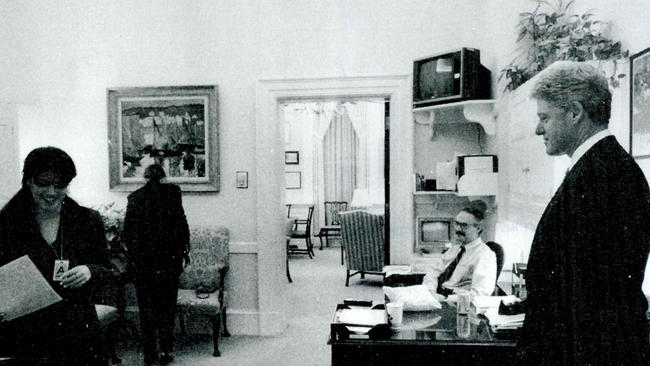 A photograph showing former White House intern Monica Lewinsky (L) working in a White House office as then-President Bill Clinton looks on. It was submitted as evidence in 1998. Picture: Supplied.