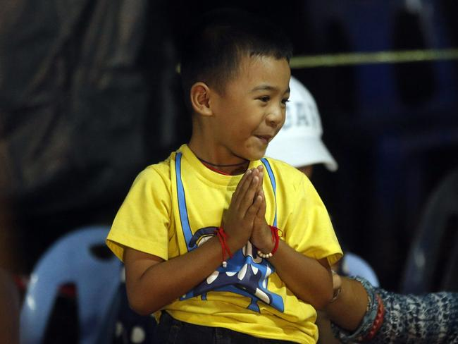 The pure joy was written on this young boy's face when families were told their loved ones were alive. Picture: AP