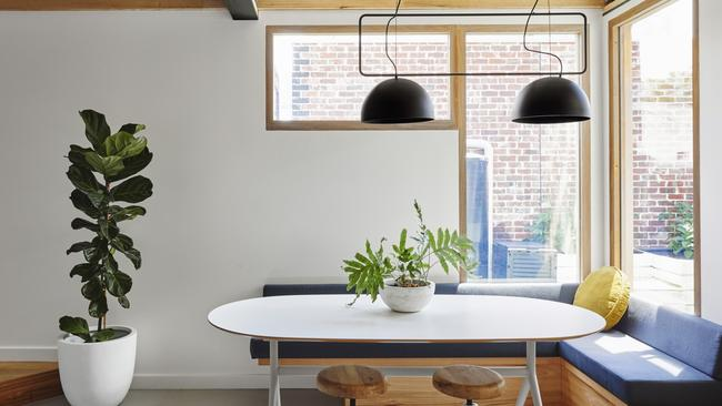 Contemporary details include low-hanging pendants and bench seating.