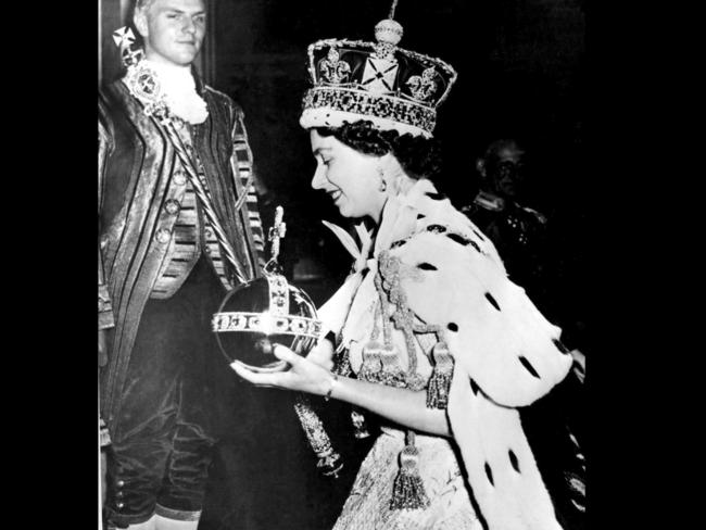 "Queen Elizabeth II at the end of her coronation ceremony, which she described as ""sort of a pageant of chivalry and (an) old-fashioned way of doing things.' Photo: AP/File"