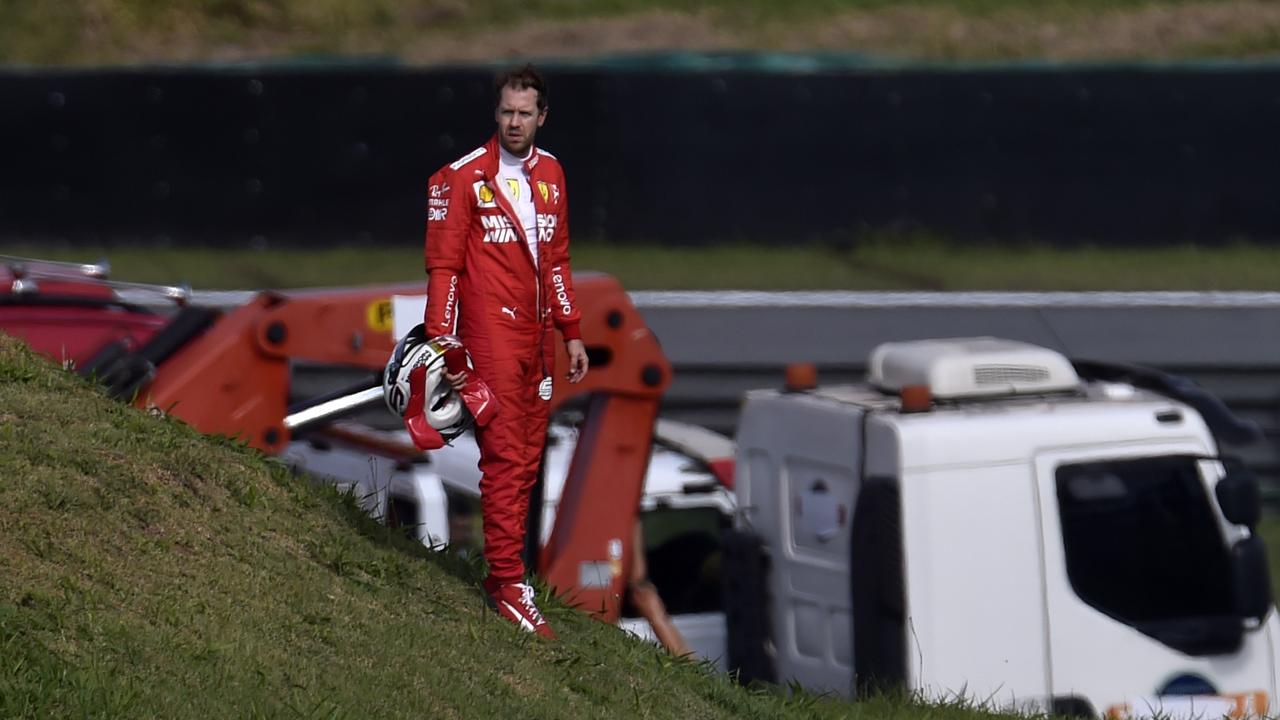 Vettel watches the race continue after retiring. Picture: Douglas Magno