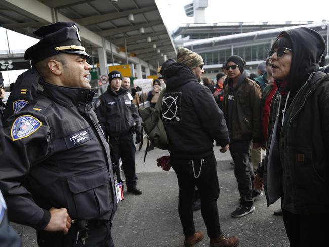 Port Authority police stand in front of protesters at John F. Kennedy International Airport in New York. Picture: AP