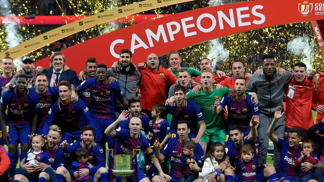 Barcelona's players pose with the trophy after winning the Spanish Copa del Rey