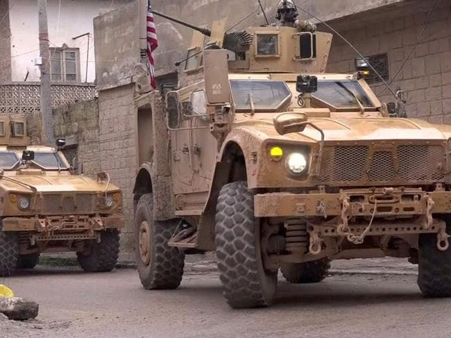 US armoured vehicles at the scene of a suicide attack in the northern Syrian town of Manbij. Picture: AFP