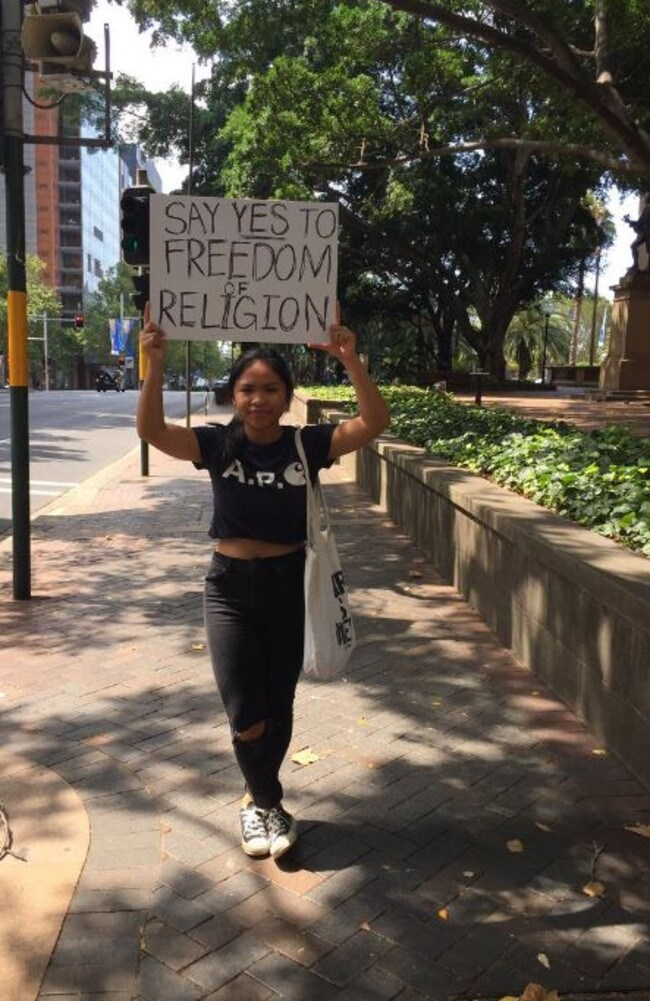 Police also warned against counter protests but all this smiling girl wanted to say was support freedom of religion. Picture: Twitter @Aarnxv.