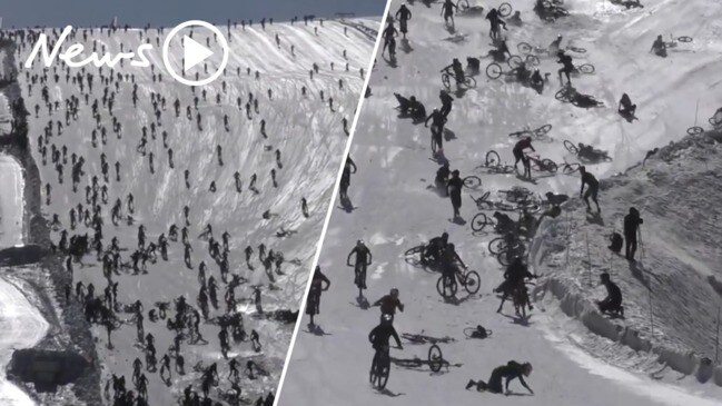 Chaos at 'Mountain of Hell' race as dozens of riders caught in glacier pile up