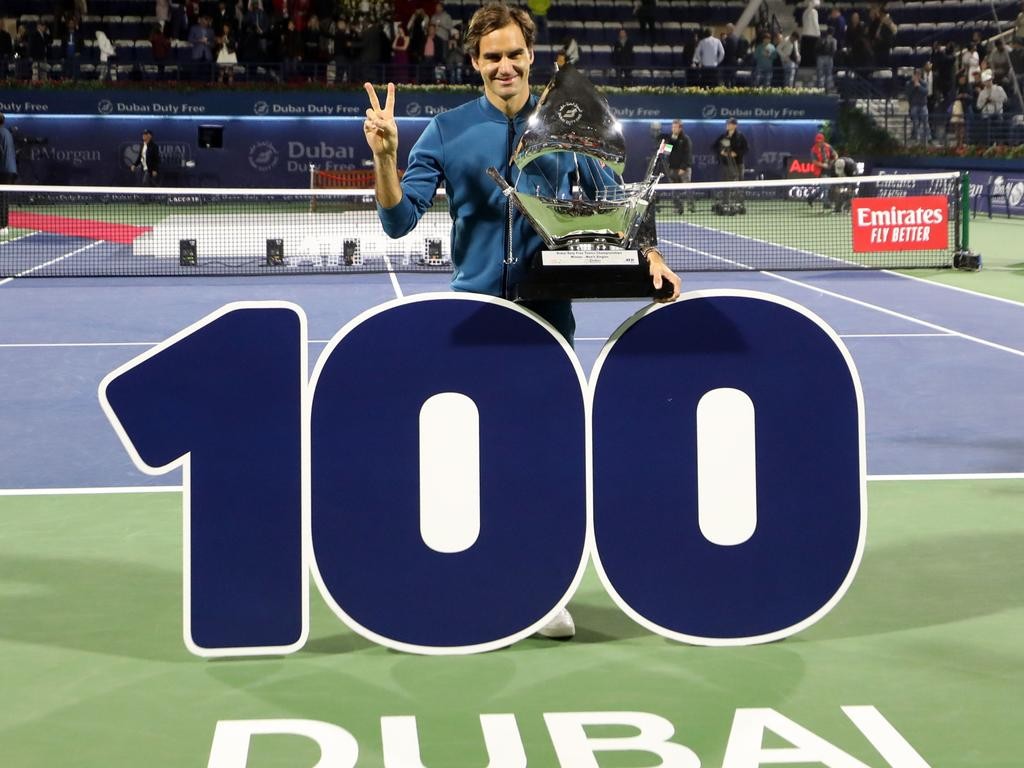 Roger Federer celebrates after winning his 100th career title.