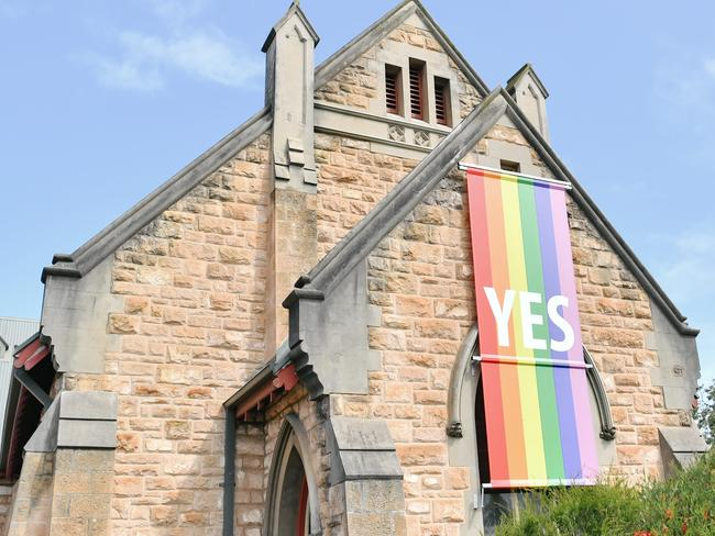 A Yes banner indicating support for same-sex marriages hangs outside a church. Picture: AAP