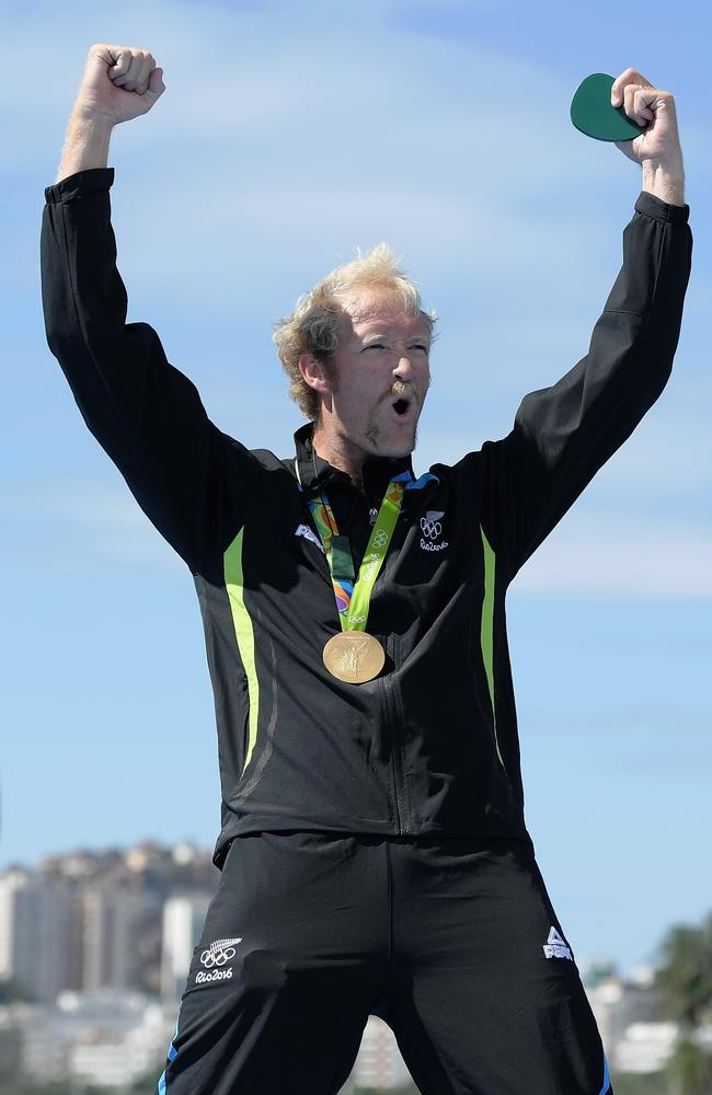 Rower Eric Murray of New Zealand celebrates the fact that he got to wear tracksuit pants onto the podium.