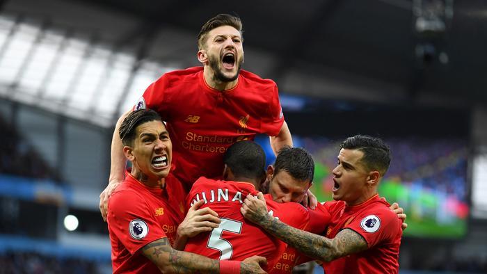 Liverpool celebrate James Milner's goal.