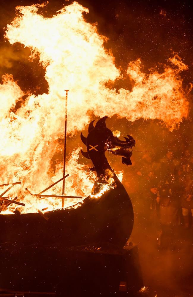 An imitation Viking longship is set alight in Lerwick, Shetland, during the traditional festival of fire, known as Up Helly Aa. Picture: Getty