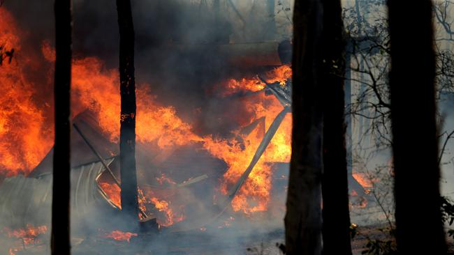 An inferno consumes a home near Taree on the NSW mid-north coast. Picture: Nathan Edwards