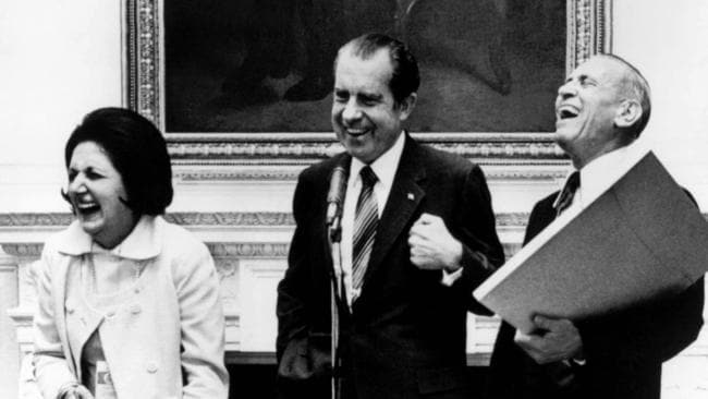 President Richard Nixon laughs with Helen Thomas in 1971.