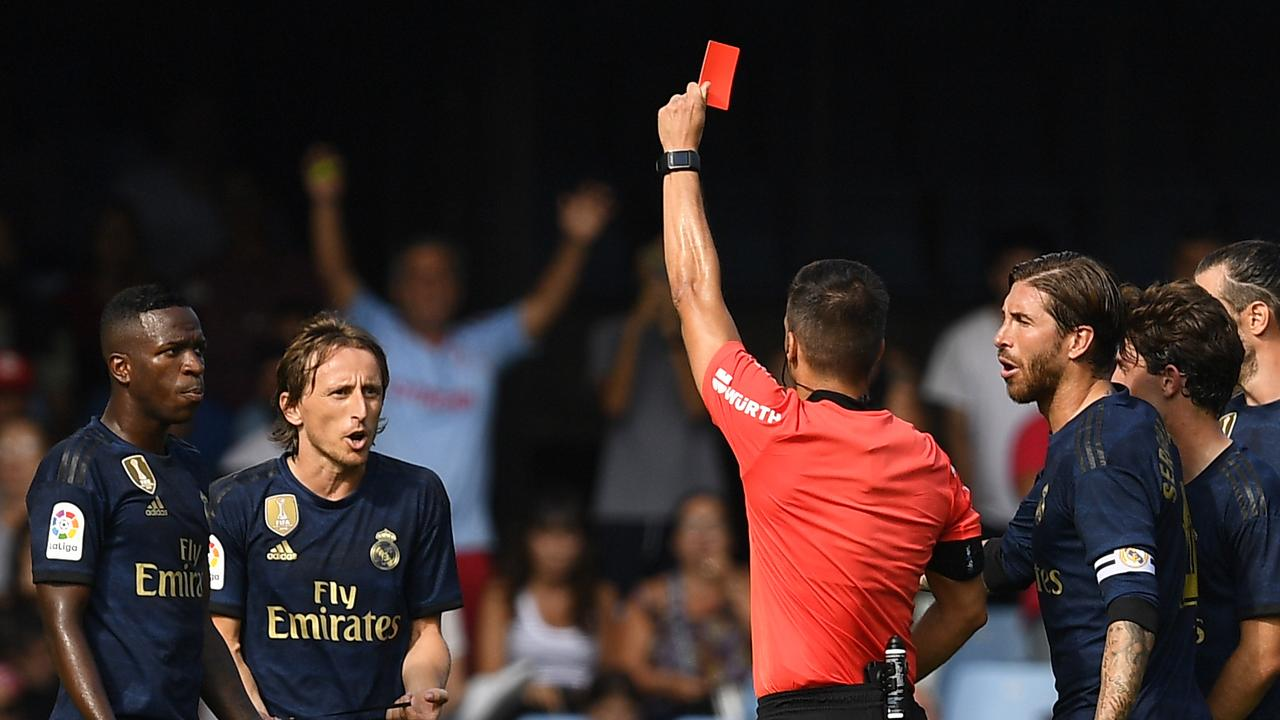 Luka Modric was shown a straight red for a blatant trip. (Photo by Octavio Passos/Getty Images)