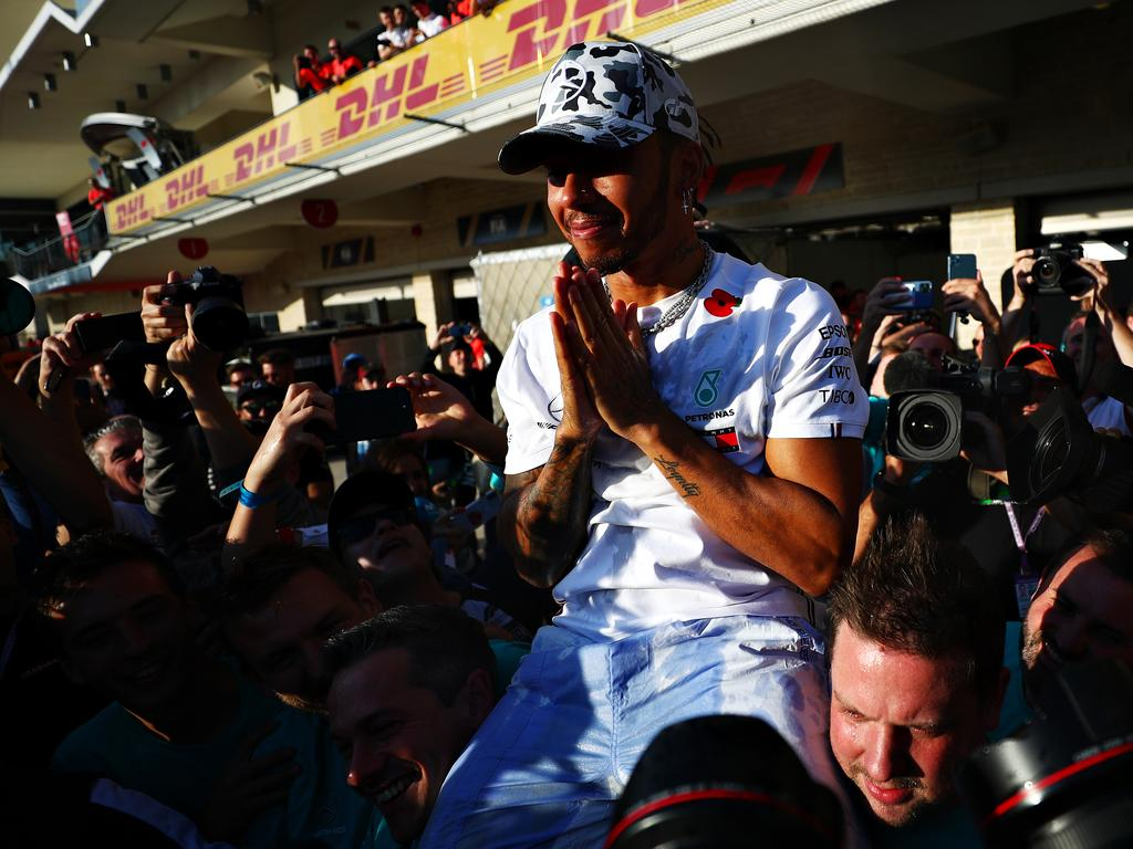 AUSTIN, TEXAS - NOVEMBER 03: 2019 Formula One World Drivers Champion Lewis Hamilton of Great Britain and Mercedes GP celebrates after the F1 Grand Prix of USA at Circuit of The Americas on November 03, 2019 in Austin, Texas. (Photo by Dan Istitene/Getty Images)