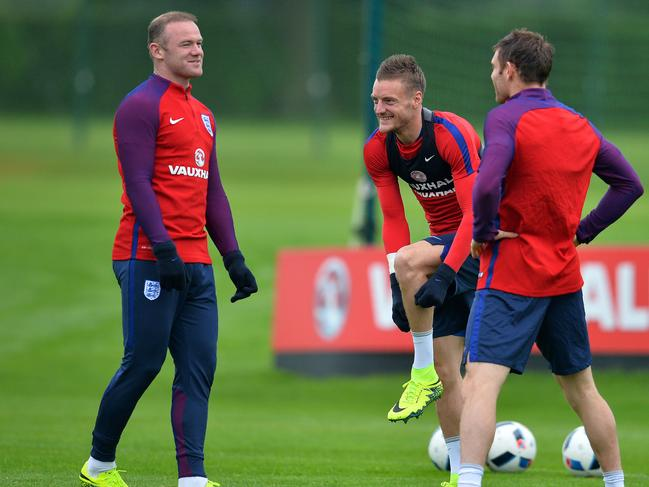 Wayne Rooney (left), and Jamie Vardy (centre) in happier times. Picture: AFP