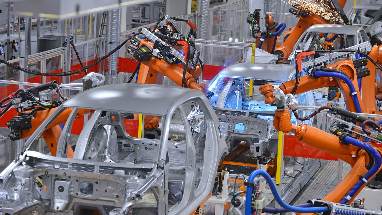 Car factories already use robots for many tasks but humans have to well clear for safety. These robots are welding.