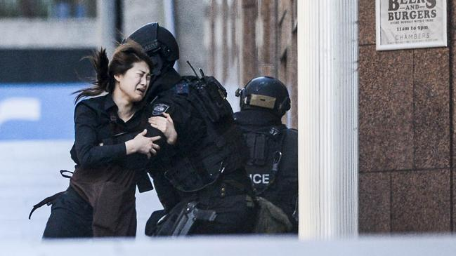 Several hostages managed to escape the Lindt Cafe. Picture: Chris McKeen
