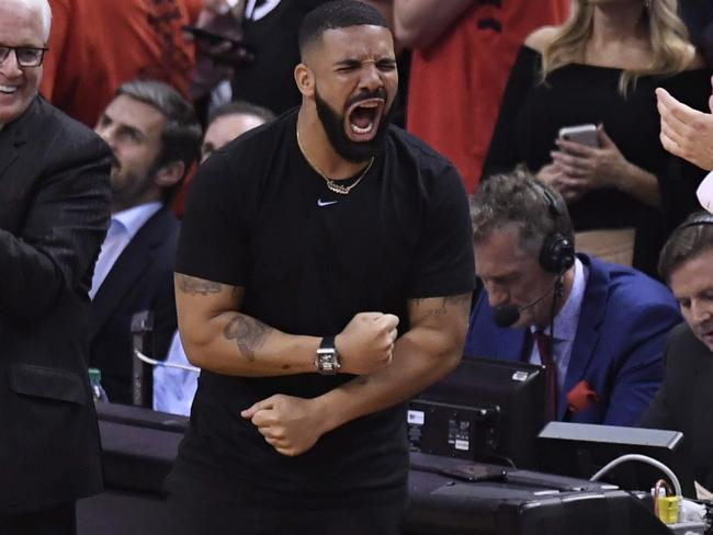 Drake reacts during the second half of basketball action between the Toronto Raptors and the Golden State Warriors. Picture: Frank Gunn/The Canadian Press