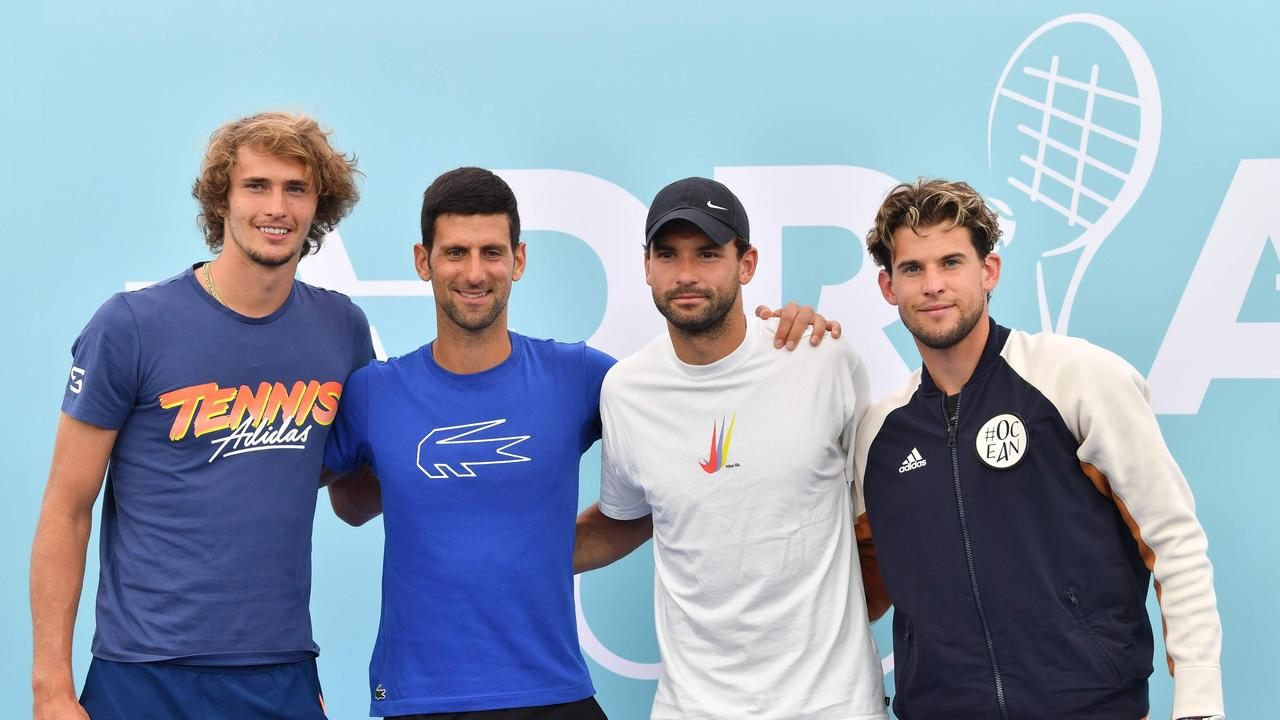 Djokovic and Dimitrov (centre), who both have coronavirus, pose during the event with Zverev and Thiem.