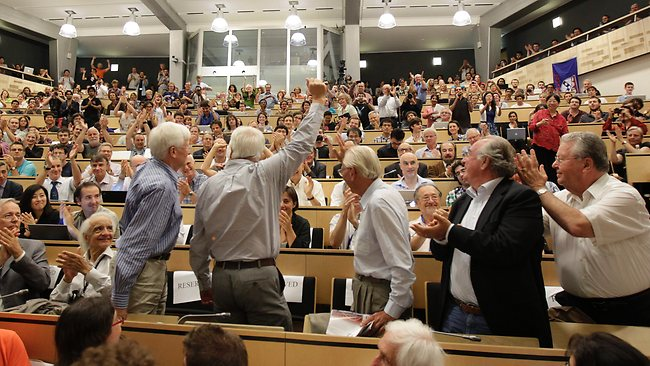 Jubilant scientists respond to the Higgs boson announcement at the Geneva seminar yesterday. Pictures: AP