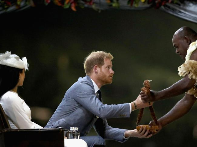 Prince Harry is presented with a gift and the Kava at the welcome ceremony. Picture: Chris Jackson