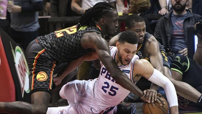 Ben Simmons, Taurean Prince, and Isaiah Taylor fight for the ball.