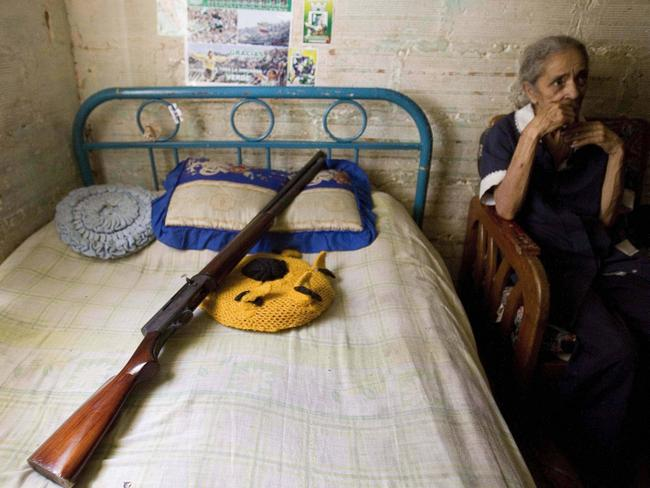 Even the elderly can be assassins, such as Margarita, pictured next to a shotgun.  <br />Picture: Getty Images