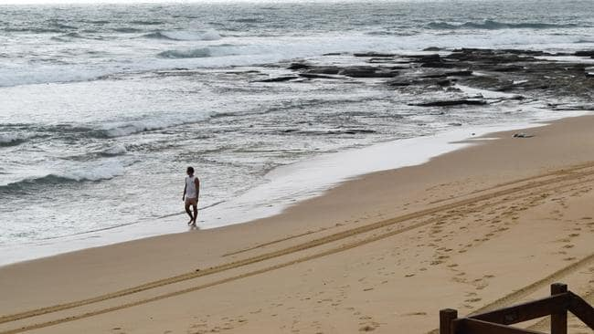 The Dicky Beach surfing community has been left reeling after the body of a young woman washed ashore early on Thursday.