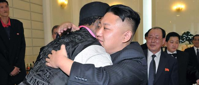 North Korean leader Kim Jong-un (front R) hugging former NBA star Dennis Rodman (front L) during a dinner. Picture: KCNA