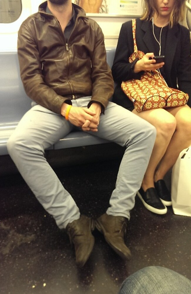 A woman squeezed to the side. Picture: Men Taking Up Too Much Space On The Train